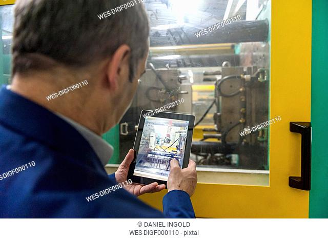 Manager doing quality assessment in plastics factory