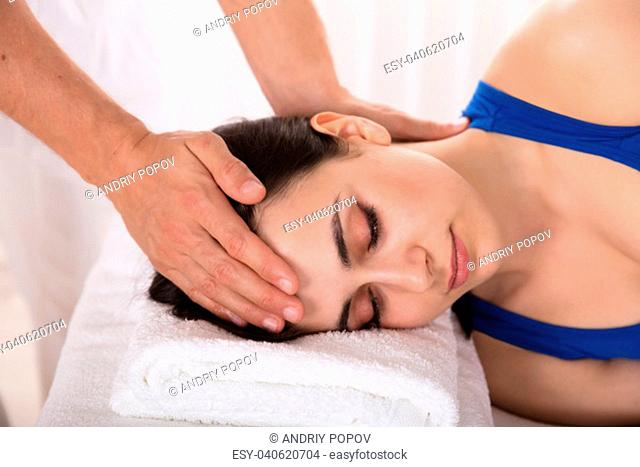 Close-up Of A Relaxed Young Woman Receiving Massage