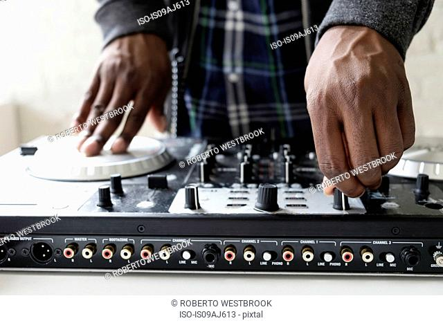 DJ using mixing desk, close up