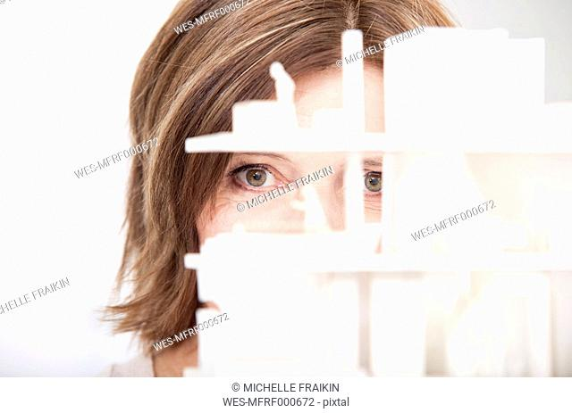 Woman watching architectural model, close-up