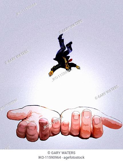 Hands cupped to catch falling man