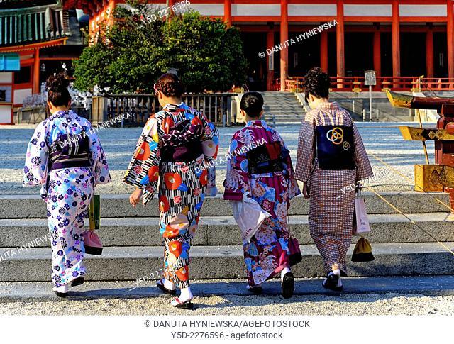 Heian Shrine - Heian Jingu - is a Shinto shrine located in Sakyo-ku, Kyoto, Japan, here young four women in kimono (traditional dress)