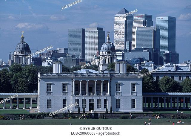 Greenwich. View over lawn toward Queens House with the Canary Wharf skyline beyond