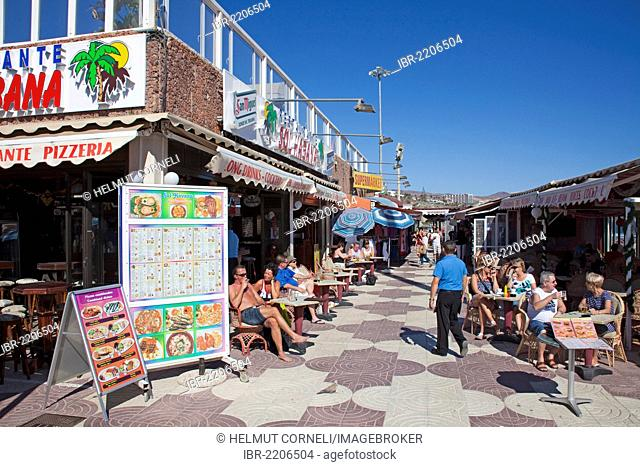 Shops and restaurants at the promenade near Playa del Ingles, Oasis, Gran Canaria, Canary Islands, Spain, Europe