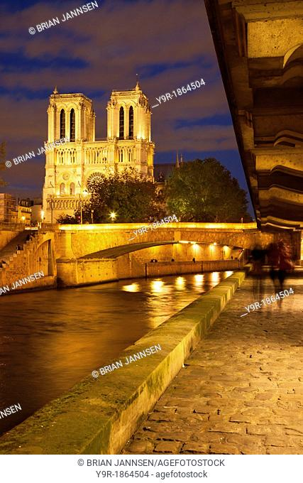 Walkway along the River Seine below Cathedral Notre Dame, Paris France