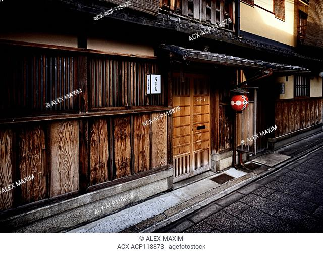 Gion Uota, Japanese restaurant with a red lantern at the entrance. Traditional Japanese architectural style with exterior finish in charred wood Shou Sugi Ban