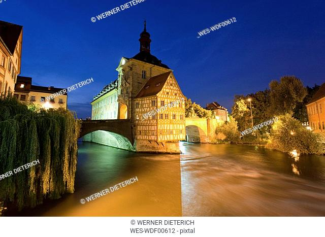 Germany, Bavaria, Franconia, Bamberg, Old City Hall over river at night