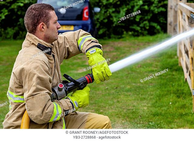 Firefighters Perform A Display At The Annual Hartfield Village Fete, Hartfield, East Sussex, UK