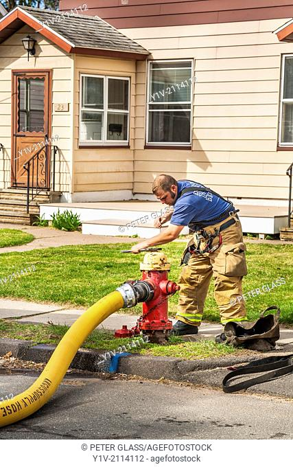 Fireman adjusting the valve on a fire hydrant