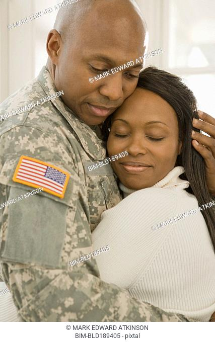 African soldier and girlfriend hugging