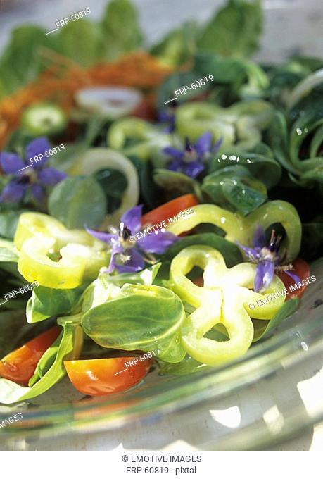 Greek salad with borage, tomatoes ans basil