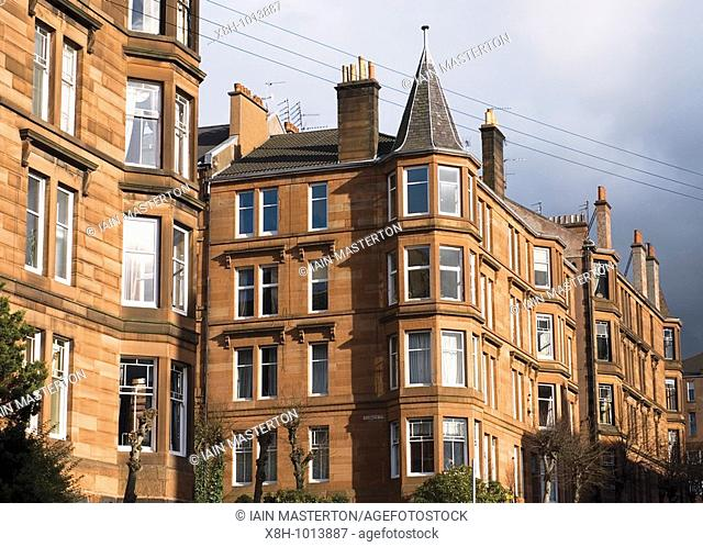 Traditional red sandstone built tenement apartment buildings in West End of Glasgow United Kingdom