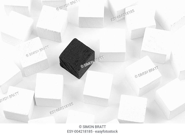 Black cube surrounded by white cubes
