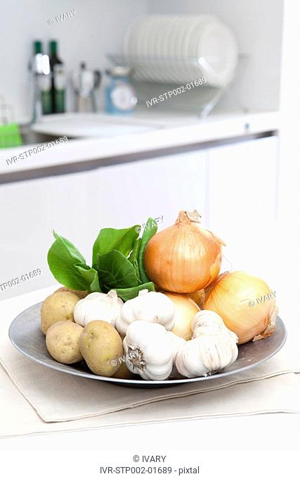 Fresh Vegetable On Plate In Kitchen
