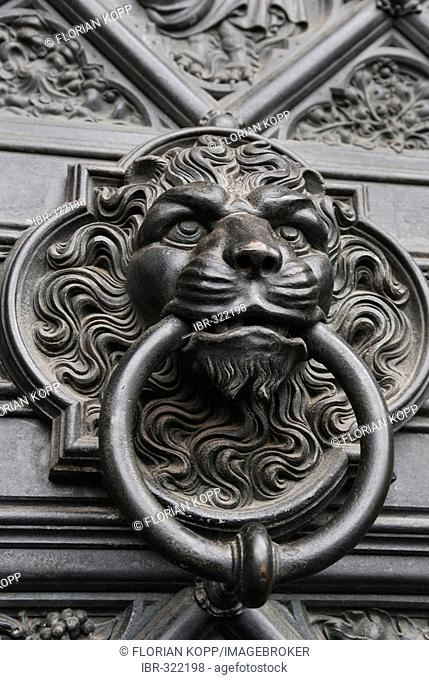 Iron lyon's had as door knocker at a side portal of the cathedral of Cologne, NRW, Germany