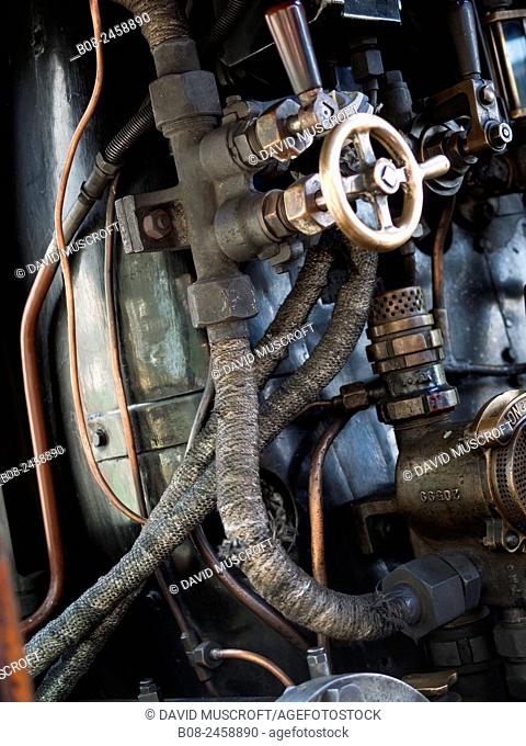 controls of a vintage steam locomotive at Loughborough station, on the Great Central Railway in Leicestershire,UK