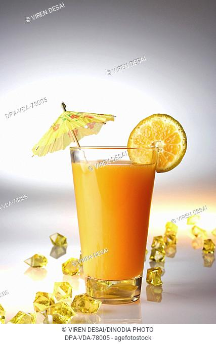 Drinks , Orange juice with an orange slice on white background with yellow acrylic pieces