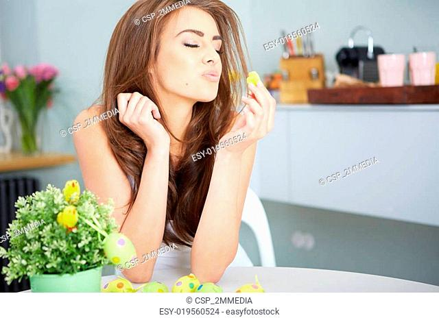 Smiling female laughing with colorful easter eggs