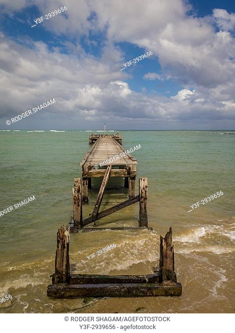 Old wooden jetty. Broken and slowly falling into the sea. False Bay, Western Cape Province, South Africa