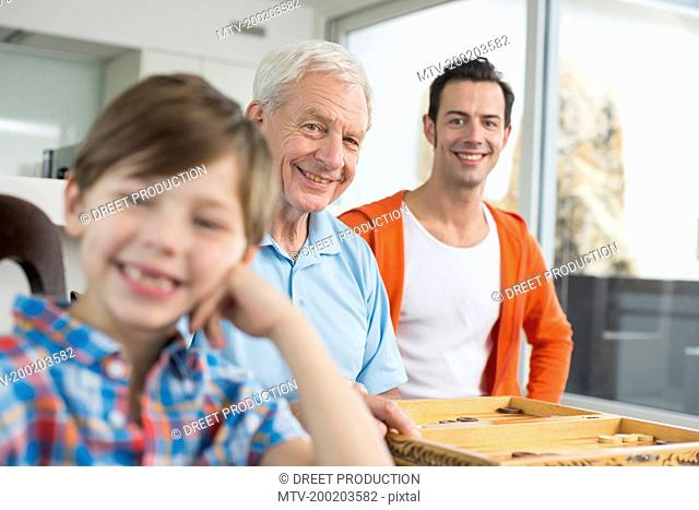 Happy boy with father and grandfather in background