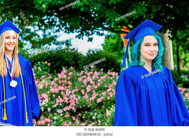 Two female students in graduation gowns