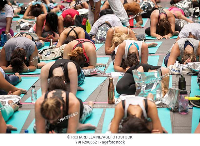 Over 12, 000 yoga practitioners pack Times Square in New York to practice yoga on the first day of summer, Wednesday, June 21, 2017