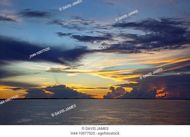 sunset, sundown, Amazon river, Amazonas, Brazil, South America, expanse, water, yellow, red, orange, blue, tinged, grey, clouds, beautiful, sun, evening