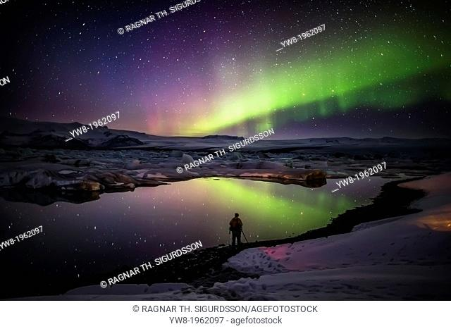 Taking pictures of the Aurora Borealis or Northern lights at the Jokulsarlon, Breidamerkurjokull, Vatnajokull Ice Cap, Iceland