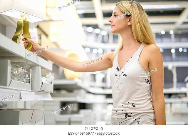 A woman shopping for furniture in a furniture store