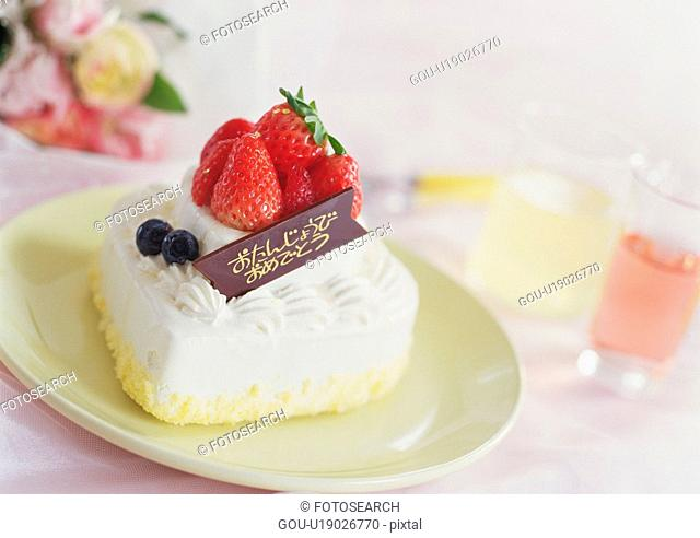 Small birthday cake with strawberry