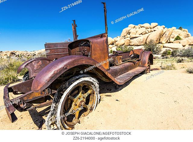 Abandonded and rusted car in the desert. Joshua Tree National Park, California, United States