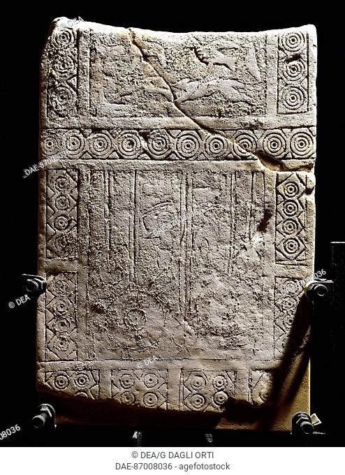 Civilization 'of Dauni, VII / VI century BC stele engraved with figures of birds and slingers.  Manfredonia, Castello Svevo-Angioino Museo Archeologico...