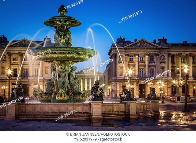 Fontaine des Fleuves - Fountain of Rivers at Place de la Concorde with L'église Sainte-Marie-Madeleine beyond, Paris France