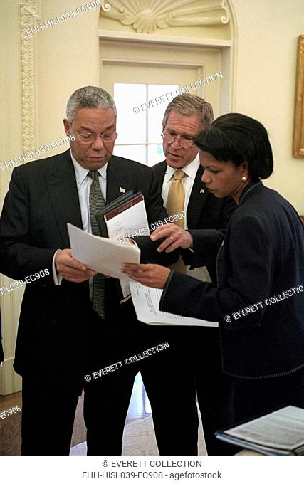 President George W. Bush prior to meeting with the Russian Foreign Minister, Sept. 19, 2001. Bush 43 with Sec. of State, Colin Powell