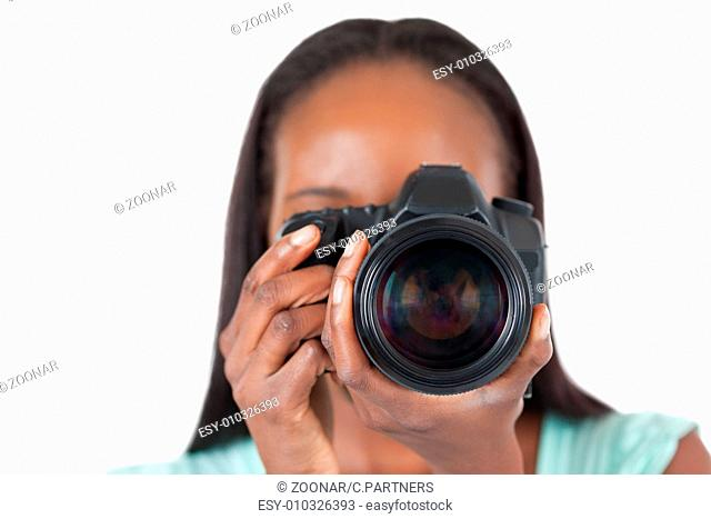 Close up of young female photographer