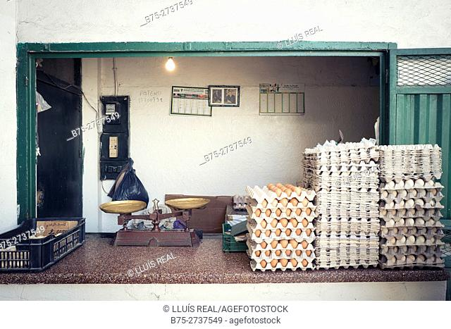Egg seller stand with old scales and egg cartons. Nouvelle Ville market, Fez, Morocco