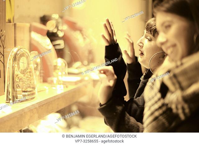 two women looking at expensive luxury jewellery in store at shop window, unattainable desire to buy, in city Cottbus, Brandenburg, Germany