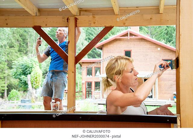 Man and woman painting outdoor