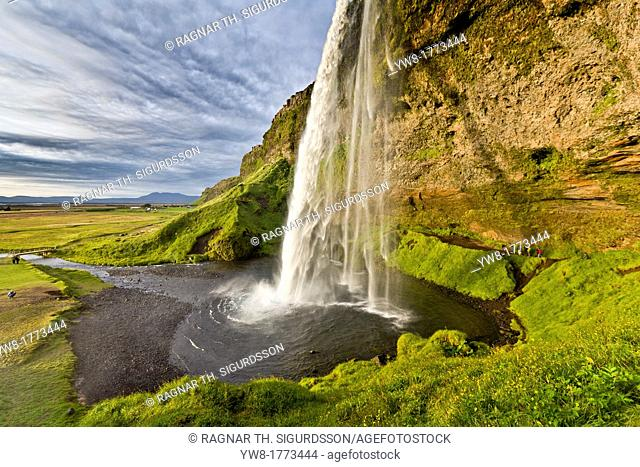Seljalandsfoss Waterfall, Iceland This waterfall drops 60 metres 200 ft over the cliffs  There is a trail behind for easy access to walk behind the falls
