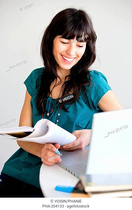 Young woman studying and using her laptop computer