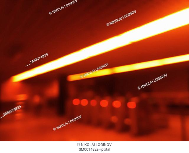 Diagonal orange lights in metro bokeh background hd