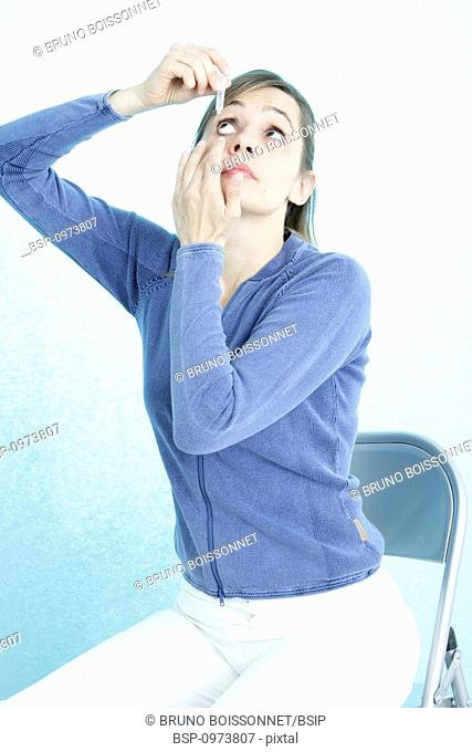 WOMAN USING EYE LOTION Model