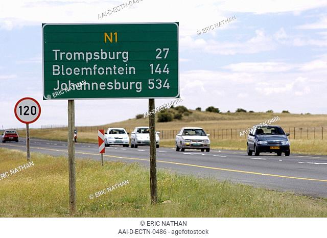 Distance sign board and passing traffic along the N1 highway in South Africa