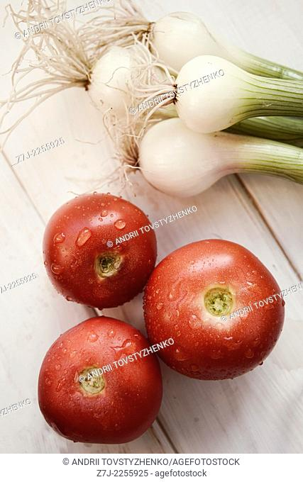 three tomatoes and green onions