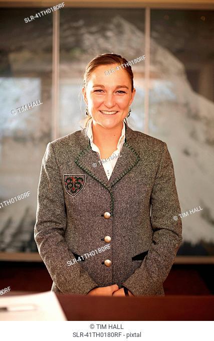 Hotel concierge standing at desk