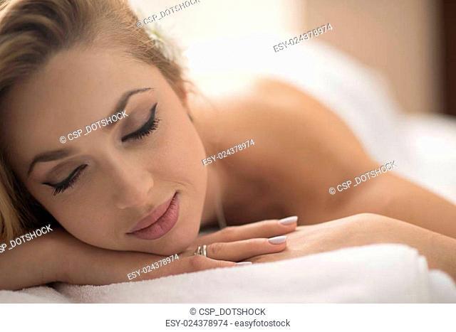 woman getting back massage in spa salon