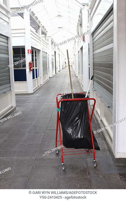 Litter bin and brush in indoor market area in rome italy