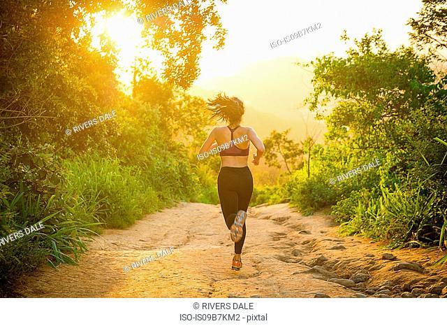 Runner training, rear view