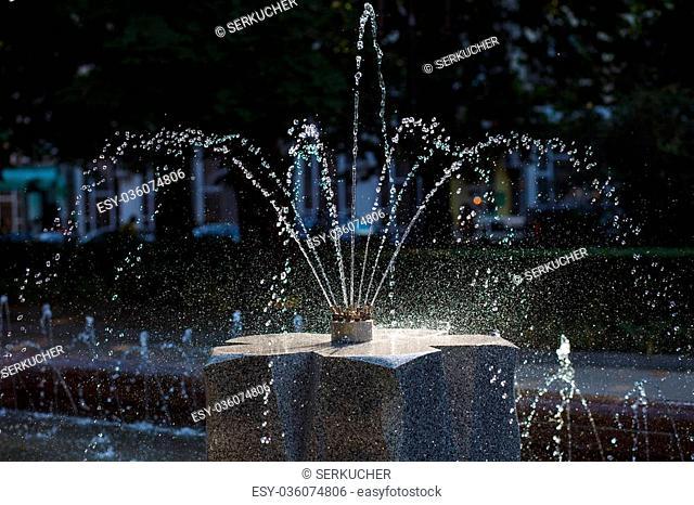 Water stream splashing on ground, Water drops watering, close up