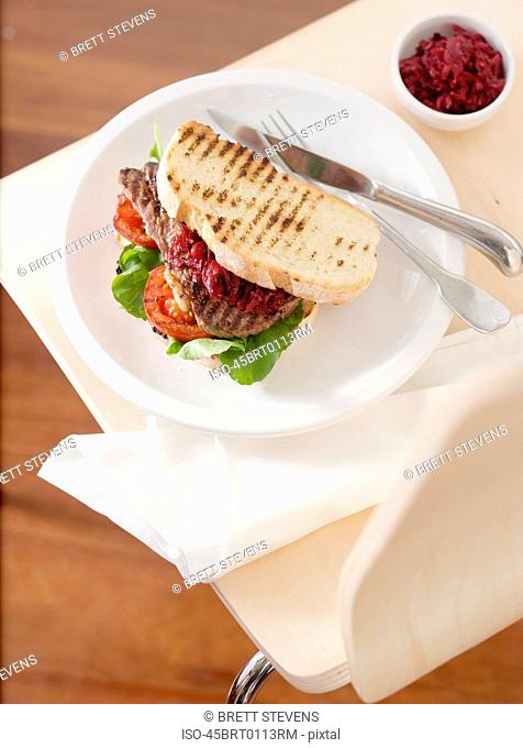Plate of grilled sandwich and sauce